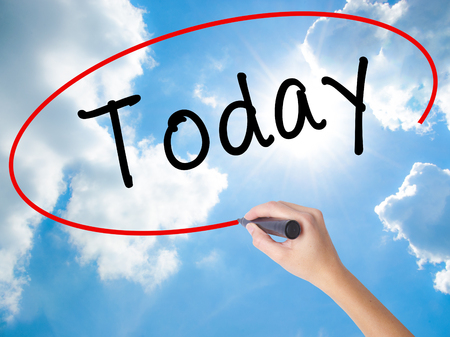 Woman Hand Writing Today with black marker on visual screen. Isolated on Sunny Sky. Business concept. Stock Photo Reklamní fotografie