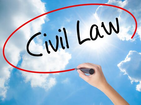 Woman Hand Writing Civil Law with black marker on visual screen. Isolated on Sunny Sky. Business, technology, internet concept.