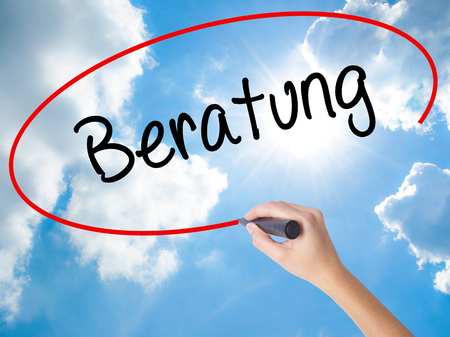 Woman Hand Writing Beratung (Advice in German) with black marker on visual screen. Isolated on Sunny Sky. Business concept. Stock Photo Stock Photo