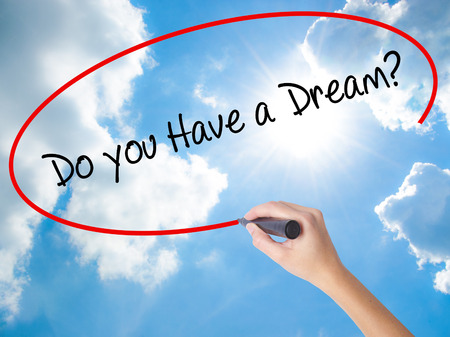 Woman Hand Writing Do you Have a Dream? with black marker on visual screen. Isolated on Sunny Sky. Business, technology, internet concept. Stock Photo