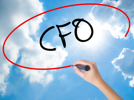 comité d entreprise: Woman Hand Writing CFO (Chief Financial Officer) with black marker on visual screen. Isolated on Sunny Sky. Business concept. Stock Photo