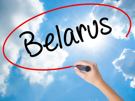 Woman Hand Writing Belarus  with black marker on visual screen. Isolated on Sunny Sky. Business, technology, internet concept. Stock  Photo Stock Photo