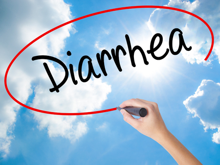 gastritis: Woman Hand Writing  Diarrhea  with black marker on visual screen. Isolated on Sunny Sky. Business concept. Stock Photo Stock Photo