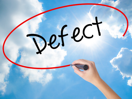 Woman Hand Writing Defect with black marker on visual screen. Isolated on Sunny Sky. Business concept. Stock Photo Stock Photo