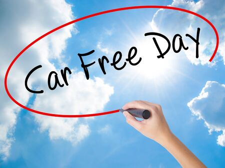 Woman Hand Writing Car Free Day with black marker on visual screen. Isolated on Sunny Sky. Business concept. Stock Photo Stock Photo
