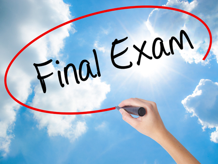 Woman Hand Writing Final Exam with black marker on visual screen. Isolated on Sunny Sky. Business concept. Stock Photo Stock Photo