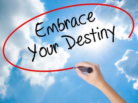 leadership potential: Woman Hand Writing Embrace Your Destiny with black marker on visual screen. Isolated on Sunny Sky. Business, technology, internet concept. Stock  Photo
