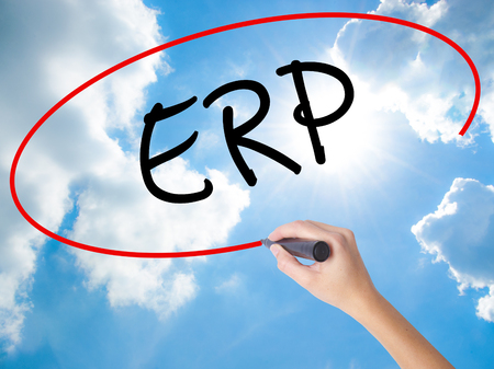Woman Hand Writing  ERP (Enterprise Resource Planning)   with black marker on visual screen. Isolated on Sunny Sky. Business concept. Stock Photo Stock Photo