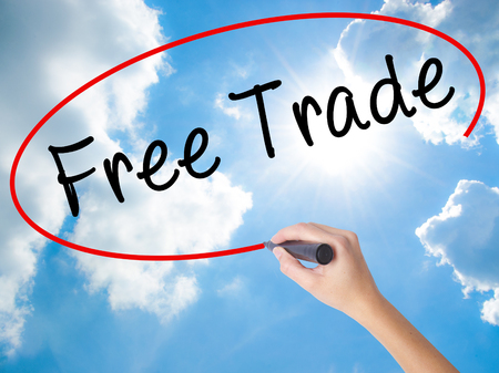career fair: Woman Hand Writing Free Trade with black marker on visual screen. Isolated on Sunny Sky. Business concept. Stock Photo Stock Photo