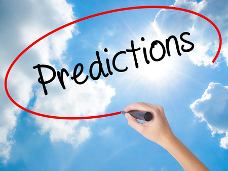 Woman Hand Writing Predictions  with black marker on visual screen. Isolated on Sunny Sky. Business concept. Stock Photo