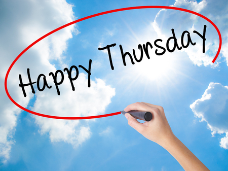 workday: Woman Hand Writing Happy Thursday with black marker on visual screen. Isolated on Sunny Sky. Business, technology, internet concept. Stock  Photo
