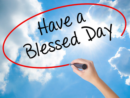 think through: Woman Hand Writing Have a Blessed Day  with black marker on visual screen. Isolated on Sunny Sky. Business concept. Stock Photo Stock Photo