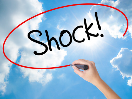 disbelief: Woman Hand Writing Shock! with black marker on visual screen. Isolated on Sunny Sky. Business concept. Stock Photo Stock Photo