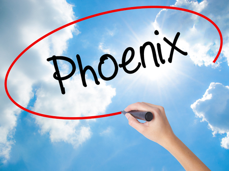 stone of destiny: Woman Hand Writing Phoenix  with black marker on visual screen. Isolated on Sunny Sky. Business concept. Stock Photo Stock Photo