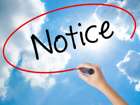 popularity: Woman Hand Writing Notice with black marker on visual screen. Isolated on Sunny Sky. Business concept. Stock Photo