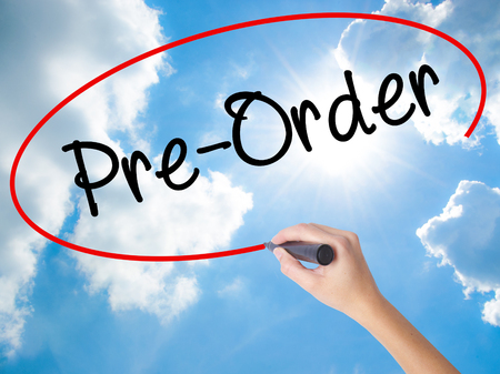 preparatory: Woman Hand Writing Pre-Order  with black marker on visual screen. Isolated on Sunny Sky. Business concept. Stock Photo