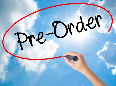 preorder: Woman Hand Writing Pre-Order  with black marker on visual screen. Isolated on Sunny Sky. Business concept. Stock Photo