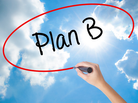 Woman Hand Writing Plan B with black marker on visual screen. Isolated on Sunny Sky. Business concept. Stock Photo