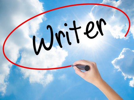 Woman Hand Writing Writer with black marker on visual screen. Isolated on Sunny Sky. Business concept. Stock Photo