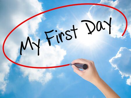 first year student: Woman Hand Writing My First Day with black marker on visual screen. Isolated on Sunny Sky. Business, technology, internet concept. Stock Photo