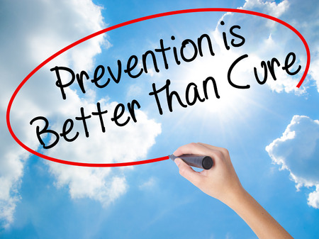 Woman Hand Writing Prevention is Better than Cure with black marker on visual screen. Isolated on Sunny Sky. Business concept. Stock Photo Stock Photo
