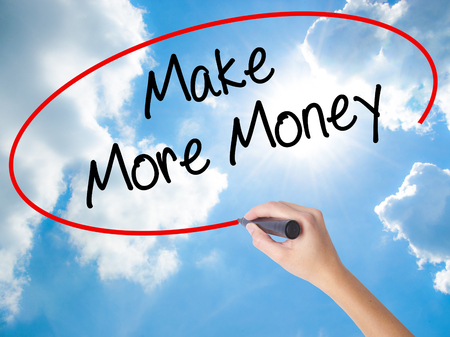 Woman Hand Writing Make Money Money  with black marker on visual screen. Isolated on Sunny Sky. Business concept. Stock Photo