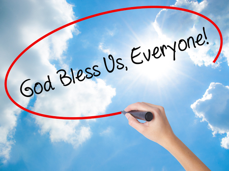 preachment: Woman Hand Writing God Bless Us, Everyone! with black marker on visual screen. Isolated on Sunny Sky. Business concept. Stock Photo