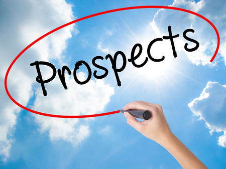 Woman Hand Writing Prospects with black marker on visual screen. Isolated on Sunny Sky. Business concept. Stock Photo