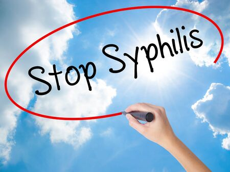 educacion sexual: Woman Hand Writing Stop Syphilis with black marker on visual screen. Isolated on Sunny Sky. Business concept. Stock Photo