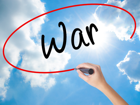 compañerismo: Woman Hand Writing War with black marker on visual screen. Isolated on Sunny Sky. Business concept. Stock Photo