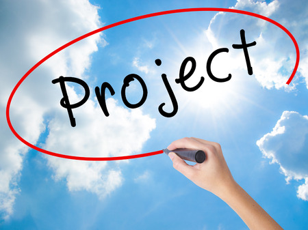 diagrama de flujo: Woman Hand Writing Project with black marker on visual screen. Isolated on Sunny Sky. Business concept. Stock Photo