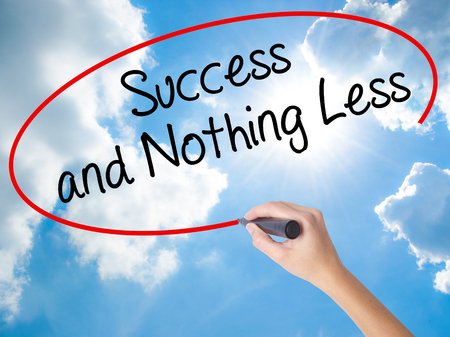 work less: Woman Hand Writing Success and Nothing Less with black marker on visual screen. Isolated on Sunny Sky. Business concept. Stock Photo