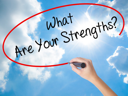 Woman Hand Writing What Are Your Strengths? with black marker on visual screen. Isolated on Sunny Sky. Business concept. Stock Photo Stock Photo