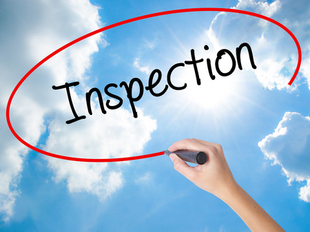 warranty questions: Woman Hand Writing Inspection with black marker on visual screen. Isolated on Sunny Sky. Business concept. Stock Photo