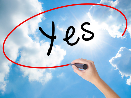 opinions: Woman Hand Writing Yes with black marker on visual screen. Isolated on Sunny Sky. Business concept. Stock Photo Stock Photo