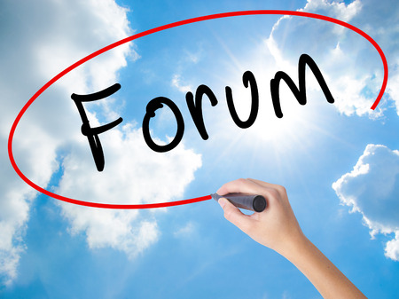 Woman Hand Writing Forum black marker on visual screen. Isolated on Sunny Sky. Business concept. Stock Photo