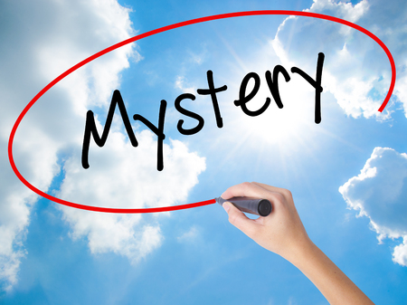 inference: Woman Hand Writing Mystery with black marker on visual screen. Isolated on Sunny Sky. Business concept. Stock Photo