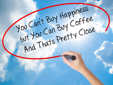 cant: Woman Hand Writing You Cant Buy Happiness but You Can Buy Coffee And Thats Pretty Close with black marker on visual screen. Isolated on Sunny Sky. Business, technology, internet concept.