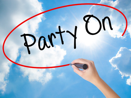 strip club: Woman Hand Writing Party On with black marker on visual screen. Isolated on Sunny Sky. Business concept. Stock Photo