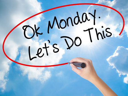 acceptable: Woman Hand Writing Ok Monday. Lets Do This with black marker on visual screen. Isolated on Sunny Sky. Business concept. Stock Photo