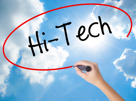Woman Hand Writing Hi-Tech with black marker on visual screen. Isolated on Sunny Sky. Business concept. Stock Photo