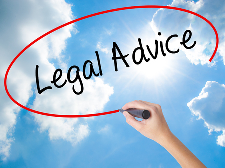 Woman Hand Writing Legal Advice with black marker on visual screen. Isolated on Sunny Sky. Business concept. Stock Photo