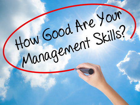 the requirement: Woman Hand Writing How Good Are Your Management Skills? with black marker on visual screen. Isolated on Sunny Sky. Business concept. Stock Photo