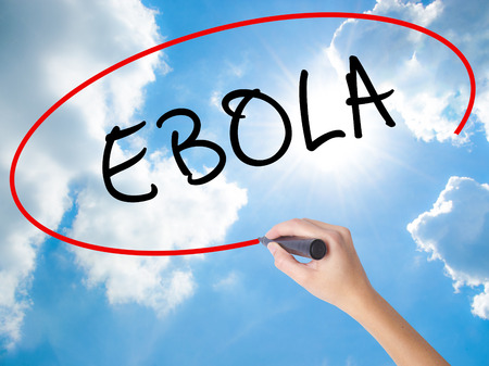 transmit: Woman Hand Writing Ebola with black marker on visual screen. Isolated on Sunny Sky. Business concept. Stock Photo Stock Photo