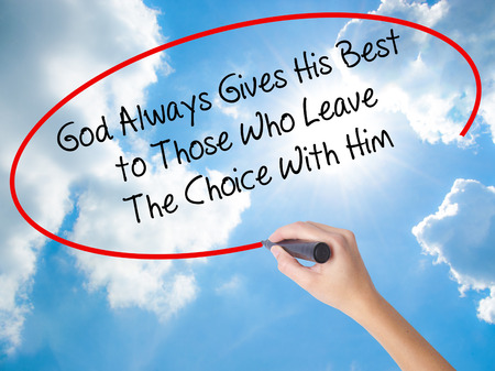 Woman Hand Writing God Always Gives His Best to Those Who Leave The Choice With Him with black marker on visual screen. Isolated on Sunny Sky. Business concept. Stock Photo