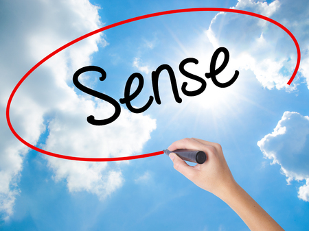 body consciousness: Woman Hand Writing  Sense with black marker on visual screen. Isolated on Sunny Sky. Business concept. Stock Photo Stock Photo