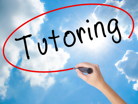 Woman Hand Writing Tutoring with black marker on visual screen. Isolated on Sunny Sky. Business concept. Stock Photo