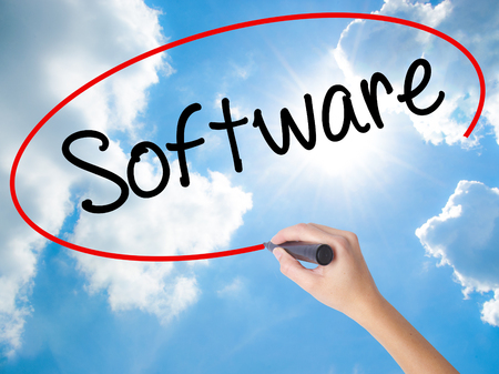 Woman Hand Writing Software  with black marker on visual screen. Isolated on Sunny Sky. Business concept. Stock Photo Stock Photo