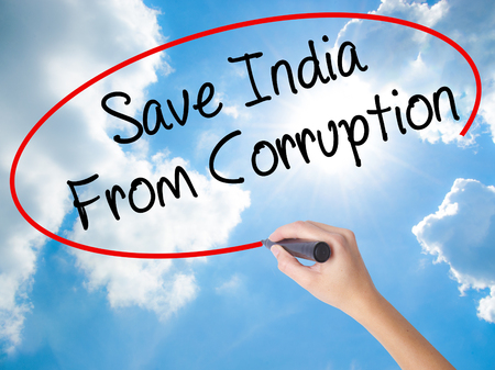 favor: Woman Hand Writing Save India From Corruption with black marker on visual screen. Isolated on Sunny Sky. Business concept. Stock Photo