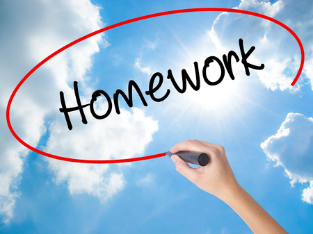 Woman Hand Writing Homework with black marker on visual screen. Isolated on Sunny Sky. Business, technology, internet concept. Stock Photo